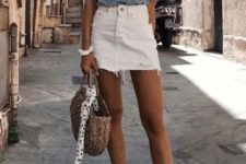 09 a blue printed tee, a white denim mini skirt, blue sneakers and a straw bag