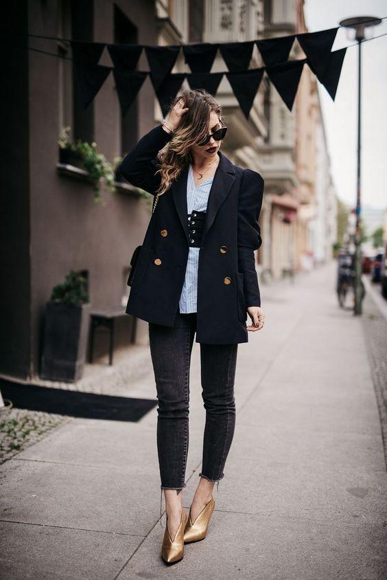 black skinnies, a blue striped shirt, a black corset belt, a black blazer and gold booties