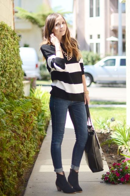 a black and white striped top, navy skinnies, a black tote, black ankle booties and a statement chunky chain