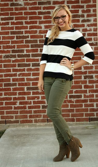 a striped top, olive green cargo pants, brown ankle booties for a casual everyday look