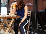 a navy sleeveless top, black side-striped pants, black heels for an everyday look