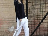 a casual look with a black turtleneck, white side-striped pants, white wedges