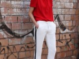 a casual outfit with a red top, white side-striped pants, black shoes for every day
