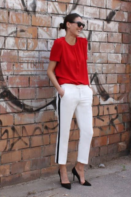 a casual outfit with a red top, white side striped pants, black shoes for every day
