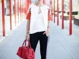 a chic outfit with a white top, a white short sleeved blazer, black side-striped pants, red shoes and a red bag