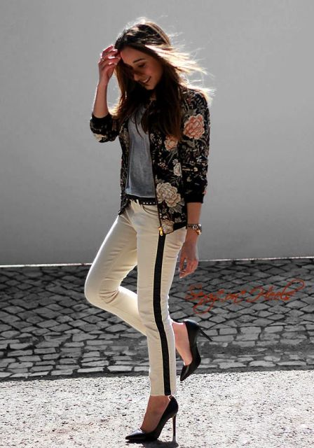 a grey tee, white side-striped pants, black shoes and a floral bomber jacket for spring