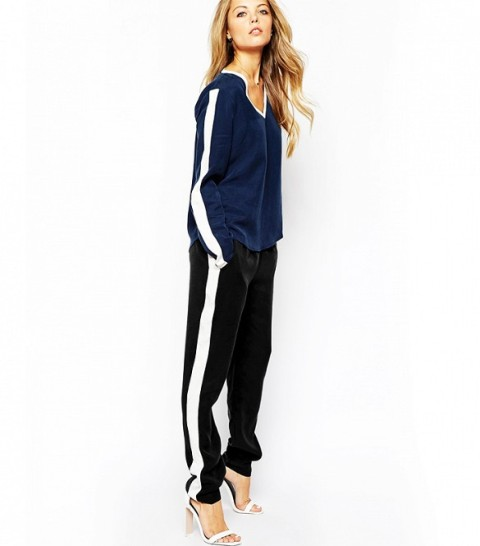 a casual outfit with a navy striped sleeve sweatshirt, black side-striped pants, white heels