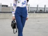a bright work look with a blue floral print shirt, blue pants, heels and a black bag is a timeless idea