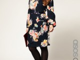 a dark floral midi dress with long sleeves, black shoes and tights for a cold spring day
