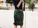 a black top with short sleeves, a dark floral pencil knee skirt and green shoes for a spring outfit
