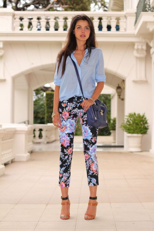 a blue oversized shirt, dark floral pants, a blue bag and two tone shoes for a spring to summer work look