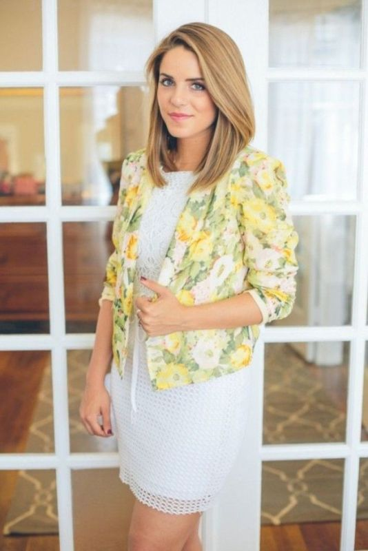 a white lace knee dress and a bold floral blazer make up a chic and bold summer work look