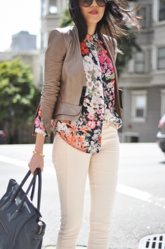 white jeans, a bright floral shirt, a tan leather jacket and a black bag to wear in spring