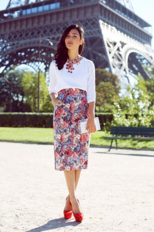 a white top, a bright floral pencil skirt, red shoes, a statement necklace and a white clutch for summer