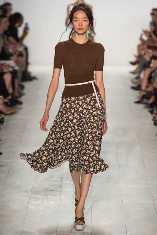 a brown top with short sleeves, a matching floral midi skirt, platform shoes for a spring work look