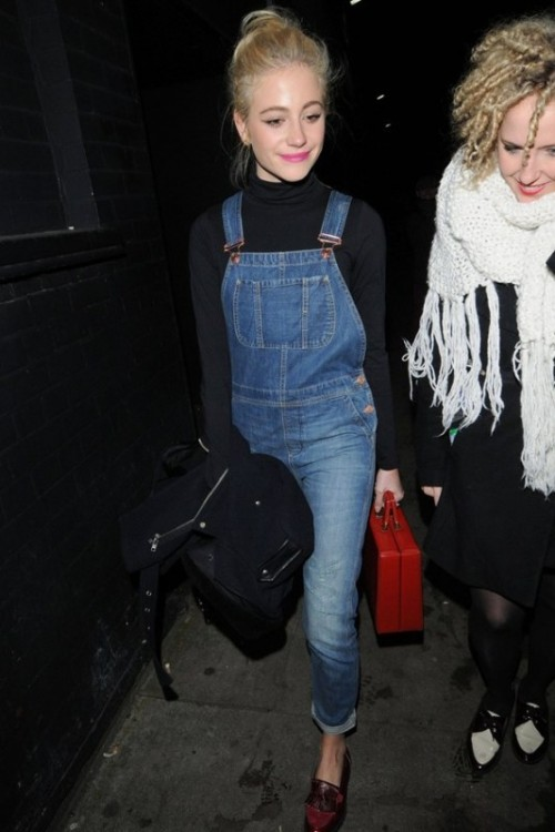 a black turtleneck, a blue denim dungaree, red moccasins and a black jacket