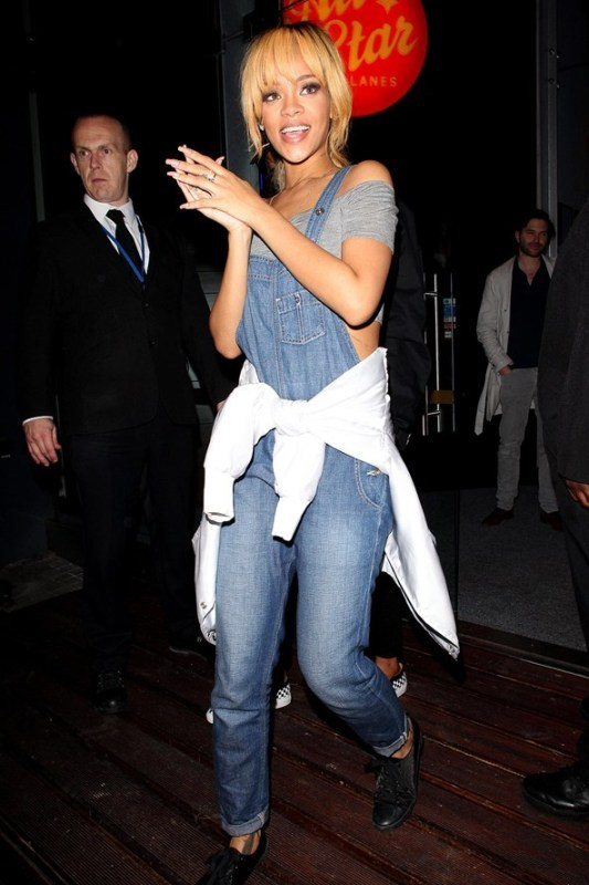 a grey off the shoulder top, a bleu denim dungaree, black boots and a white bomber jacket