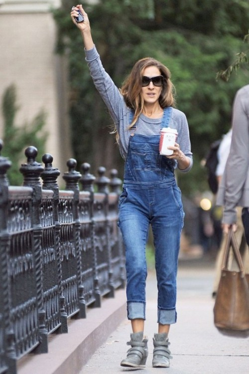 a grey sweatshirt, a blue denim dungaree and grey boots by Sarah Jessica Parker