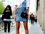 a white tee, a blue denim dungaree with a skirt, black shoes and a black bag for spring or summer