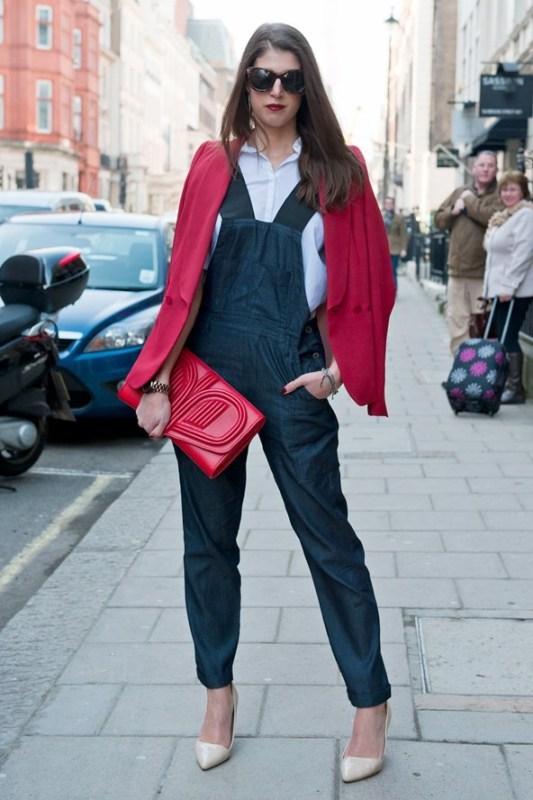 a white shirt, a navy denim dungaree, white shoes, a red blazer and a red oversized clutch