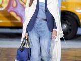 a white shirt, a light blue denim dungaree, a navy blazer, black shoes, a white trench and a blue bag