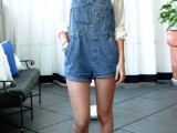 a white shirt with a black bow, a blue denim dungaree with shorts and silver flats