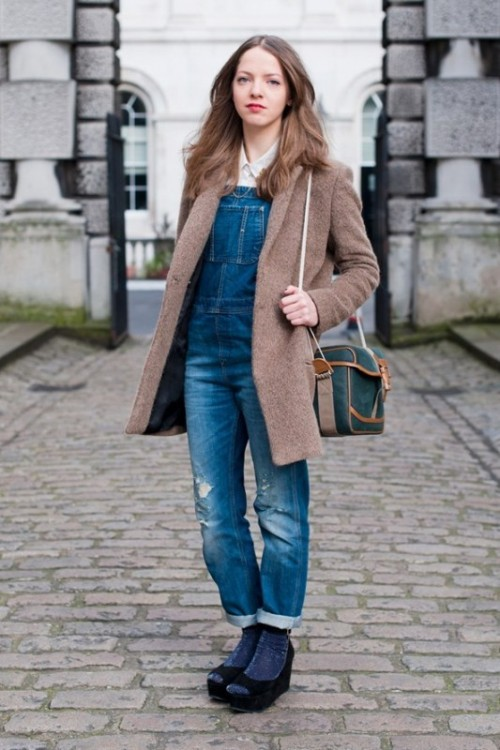 a white shirt, a blue denim dungaree, platform shoes and a brown coat for a cold spring day