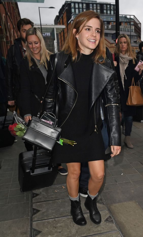 a black knit dress, black boots and grey socks, a black leather jacket and a mini bag