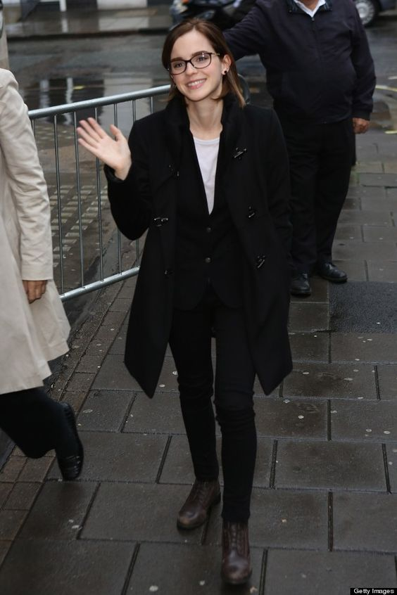 a monochromatic outfit with a white tee, a black waistcoat and skinnies, a duffy coat and brown boots