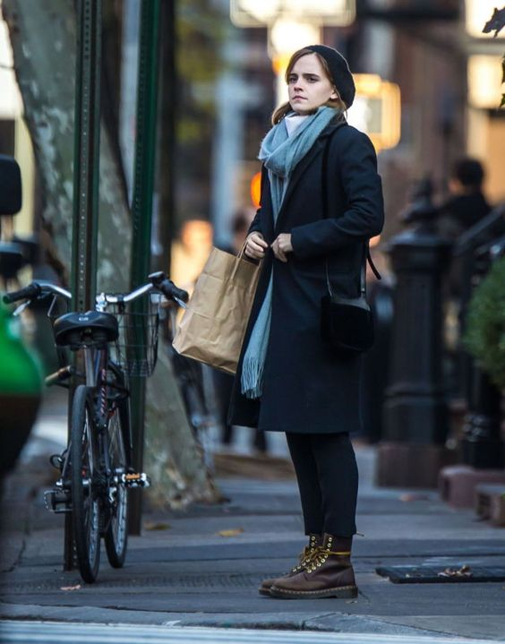 a navy coat, a blue scarf, a beret, brown boots and a black bag to rock in fall or winter