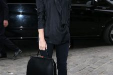 a smart casual look with a silk black shirt, black skinnies, heels and a stylish minimalist bag