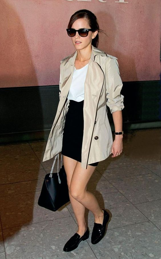 a stylish mono chromatic outfit with a white top, a black mini skirt, black loafers and a bag and a grey short trench
