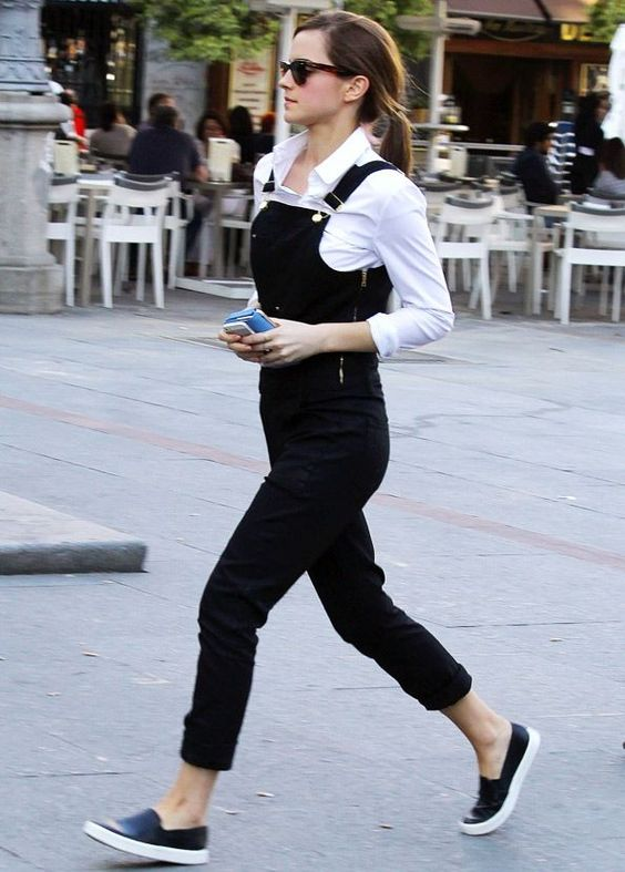 a white shirt, a black overall, black slipons for a casual monochromatic look