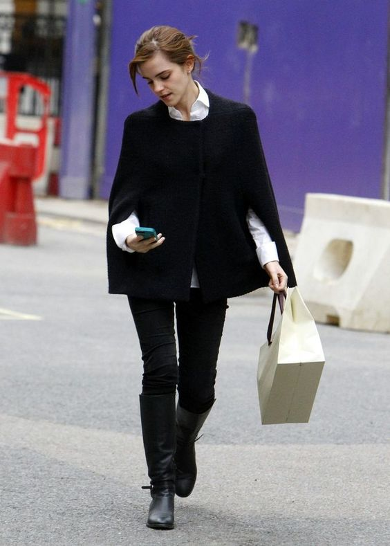 an ultimate look with a white shirt, black skinnies, tall boots and a cape is in trend