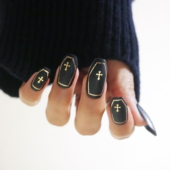 black coffin nails with gold framing and crosses are stylish, spooky and very elegant, perfect for Halloween