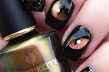 glossy black nails with eyes and scallops look very elegant, refined and very bold at the same time