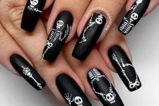 matte black and white skeleton nails for Halloween will always be cool and popular