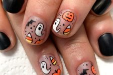 matte lack and nude nails with candy corns, ghosts and bats are all cute and super chic for Halloween