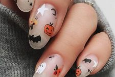 matte nude nails with ghosts, bats, moons, stars and pumpkins are amazing and super fun
