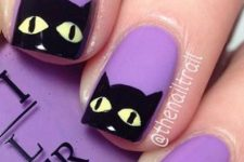 purple nails with black cats are always fun, cute and whimsical, you'll enjoy them for sure