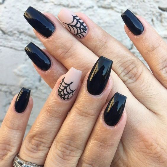 stylish and simple black and nude nails with spoderwebs are amazing for Halloween