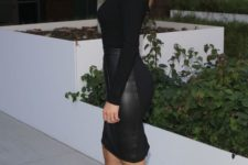a black leather skirt, a black turtleneck, leopard print shoes and a red lip for a striking look