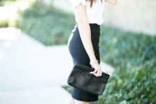 a black pencil knee skirt to accent your curves, a white t-shirt, black ankle strap shoes and a small black clutch