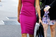 a fitting gown is always a win – a tailored fuchsia-colored kneed dress with no sleeves, silver pumps and a black bag