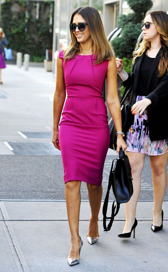 a fitting gown is always a win - a tailored fuchsia-colored kneed dress with no sleeves, silver pumps and a black bag