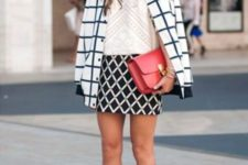 a monochromatic work look with an assortment of prints, a red bag and black lace up shoes that highlight your legs even more
