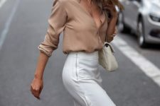 a taupe shirt, a white ruffle skirt and a creamy bag for a summer work outfit