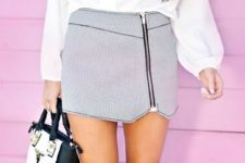 a white blouse, a printed super mini zip skirt, heels and a black and white bag