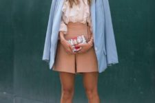 blush shorts to show off your legs, a ruffled blouse, white heels and a powder blue blazer