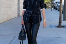 leather pants, which are always a sexy statement, a white button down, a windowpane blazer, black strappy shoes and a black bag